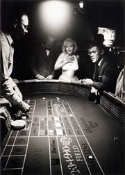Sale 8545A - Lot 5028 - Eve Arnold (1912 - 2012) - Marilyn Monroe and Mistfit crew at Christmas Tree Inn & Casino in Nevada 43 x 30.5cm (mount size: 72 x 54...