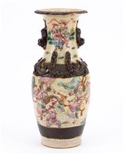 Sale 8855D - Lot 631 - An antique Chinese polychrome vase with applied mythical creature handles. Evidence of vase being converted to lamp at some stage wi...