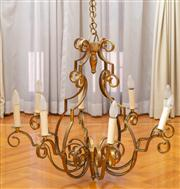 Sale 8630A - Lot 25 - An eight branch chandelier in wrought iron with antique gold finish, drop 70cm, ex Pia Francesca Design