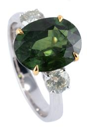Sale 8974 - Lot 395 - AN 18CT WHITE GOLD SAPPHIRE AND TWO DIAMOND RING; featuring an oval cut green treated sapphire of 5.36ct (few small chips), adjacent...