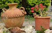 Sale 9070H - Lot 201 - A large terracotta vessel (damages to handles) together with a terracotta pot planted with geraniums. Height of vessel approx 64cm x...