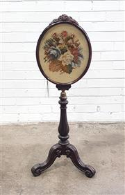 Sale 9068 - Lot 1064 - Victorian Rosewood Pole Screen, the oval frame with floral needle-work & carved crest, on an adjustable turned pedestal, with...