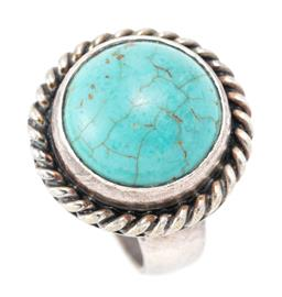 Sale 9169 - Lot 397 - A SILVER TURQUOISE SET COCKTAIL RING; set with a 15mm wide cabochon turquoise to wire twist surround, width 22mm, size O 1/2, wt. 12...