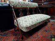 Sale 8576 - Lot 1010 - Victorian Walnut Settee, with carved splats & braces extending into legs, upholstered in a cream diamond patterned fabric