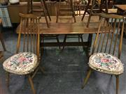 Sale 8643 - Lot 1124 - Ercol Elm Table with Set of 4 Chairs