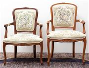 Sale 8940J - Lot 80 - Two similar Louis style vintage walnut bergeres. The backs and seats upholstered in scenic machine tapestries each with carved and s...