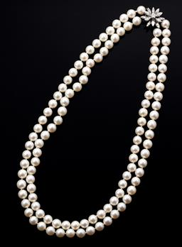 Sale 9099 - Lot 89 - A fully knotted double row Akoya pearl necklace with a 18ct white gold diamond set star design clasp. Pearls: 112; good cream whit...