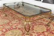 Sale 8630A - Lot 27 - A wrought iron and glass top octagonal coffee table with square canted corners, the gilt frame on scrolled support, H 47 x W 150 x D...