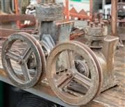 Sale 8984W - Lot 596 - Two fly wheel engine casings, the taller 30cm