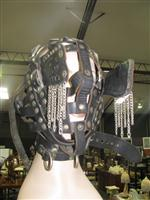 Sale 7926A - Lot 1664 - Leather Head Gear mask marked I belong to salon kittys, hand crafted by slave Anton