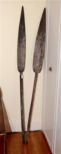 Sale 8171A - Lot 61 - A selection of two Papua New Guinean hardwood paddles, each modelled with linear decoration, H 180cm