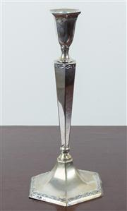 Sale 8435A - Lot 67 - A Continental silver hexagonal form candle stick with vine motif, dent to base, H 26cm, together with a snuffer