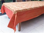 Sale 8568A - Lot 128 - An Italian burnt orange shot silk floral arabesque table cloth, (made bespoke to fit lot 126 dining table)