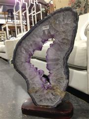 Sale 8744 - Lot 1016 - Horizontal Cut Amethyst on Stand