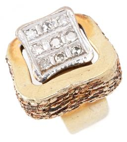 Sale 9149 - Lot 342 - A VINTAGE 14CT GOLD DIAMOND BUCKLE RING; 17 x 14mm textured buckle to 9ct white gold tongue section set with 9 single cut diamonds t...