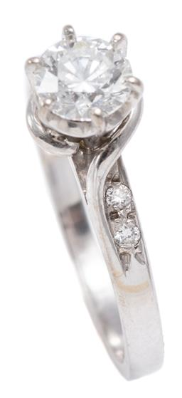 Sale 9164J - Lot 422 - AN 18CT WHITE GOLD DIAMOND RING; 6 claw set with a round brilliant cut diamonds of approx. 0.62ct, P1, to bypass wrap around shoulde...