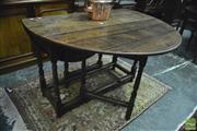 Sale 8359 - Lot 1050 - 17th Century Style Oak Gateleg Table forming an oval top and on turned legs.