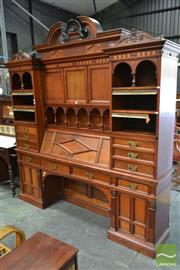Sale 8520 - Lot 1001 - Unusual Late Victorian Renaissance Style Carved Walnut Secretaire Bookcase by Howard & Sons of London, with a broken arch pediment,...