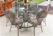 Sale 8868H - Lot 29 - An Italian wrought iron and glass table and six chairs with zebra print upholstery, the table with a finial style pedestal base, dia...
