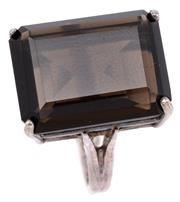 Sale 9090J - Lot 332 - A SILVER GEMSTONE COCKTAIL RING; set with an emerald cut smoky quartz of approx. 10ct on a basket mount, size L, wt. 5.5g.