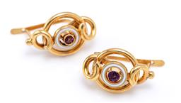 Sale 9194 - Lot 375 - A PAIR OF ENAMELLED GOLD STONE SET EARRINGS; each a round cut amethyst within a circle of white enamel applied with a swirl motif at...