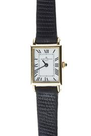 Sale 8322J - Lot 309 - A 14CT GOLD LADY'S BAUME & MERCIER WRISTWATCH; rectangular white dial with black Roman numerals on BM 5095 six jewell ETA quartz mov..