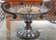 Sale 8868H - Lot 28 - An Italian urn form twin handled wrought iron and steel containing woven balls, diameter 47cm