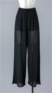 Sale 8782A - Lot 169 - A pair of Chanel high waisted loosely woven pants in black wool with silk lining, size 38