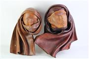 Sale 8835 - Lot 70 - Leather Wall Hangings Of Man In Hood  & Woman With Hood & Scarf Signed On Back Agosto 1995 (L 50cm)