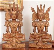Sale 8868H - Lot 30 - A pair of Balinese seated deities in traditional dress with red and gilt and mirrored highlights Height 43cm, Width 22cm