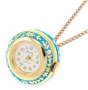 Sale 9083 - Lot 560 - VINTAGE BALL CLOCK PENDANT; 22mm round gilt clock with guilloche blue pattern on a plated curb chain, length 84cm.