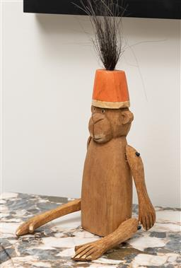 Sale 9248H - Lot 178 - A wooden monkey wearing an orange hat and articulated limbs. height 22cm