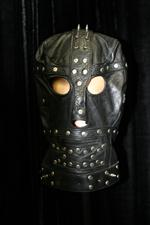 Sale 7926A - Lot 1601 - Leather studded hood on stand