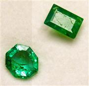 Sale 8036A - Lot 324 - TWO UNSET EMERALDS; octagonal and step cut totalling 0.60ct.