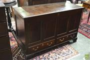Sale 8359 - Lot 1045 - 17th Century Style Oak Mule Chest with hinged lid fielded panels and two drawers  (19th century).