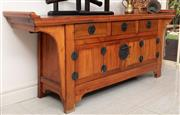 Sale 8868H - Lot 35 - A Chinese Elm three drawer, four door console with metal handles and key, Height 88cm, Width 220cm, Depth 50cm