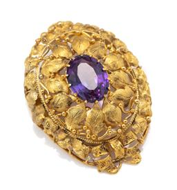 Sale 9099 - Lot 93 - A Victorian 18ct yellow gold oval floral design amethyst set brooch with a claw set oval amethyst and overall grape leaf motifs; cir...