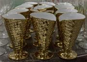 Sale 8310A - Lot 143 - A set of 8 gilded ceramic waffle cones, H 16cm
