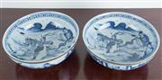 Sale 8435A - Lot 13 - A pair of oriental blue and white bowls with silvered rims with warrior decoration throughout and crackelure glaze, D 23cm