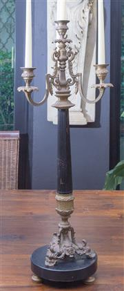 Sale 8568A - Lot 131 - A classical style four branch brass candelabrum with fluted shaft on black marble base, H 77cm