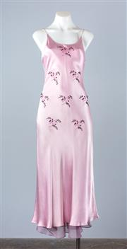 Sale 8782A - Lot 176 - A sleeveless evening dress in mauve satin with floral hand embroidery, beadwork and fluted hem