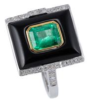 Sale 8974 - Lot 366 - A DECO INSPIRED EMERALD DIAMOND AND ONYX RING; rectangular cabochon onyx centre bezel set in yellow gold with an emerald cut emerald...