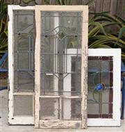 Sale 9070H - Lot 209 - Three stained glass window panes, Largest frame 114cm x 49.5cm, Smallest frame 75cm x 54cm (some rotting to wood)