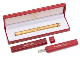 Sale 9099 - Lot 65 - A Cartier ballpoint pen; gold plated., marked 071679 to base, length 13.5cm, with two refill cases, Note: The case is dented
