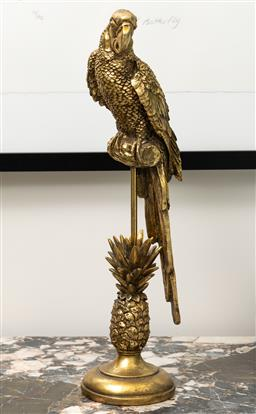 Sale 9248H - Lot 180 - A gold Parrot on a pineapple base. h 51cm