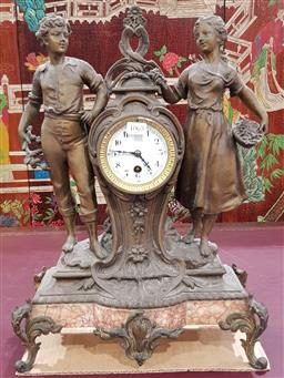 Sale 9102 - Lot 1094 - Early 20th Century French Spelter Timepiece or Mantle Clock, with a young couple standing beside an hour-glass clock with enamel dia...