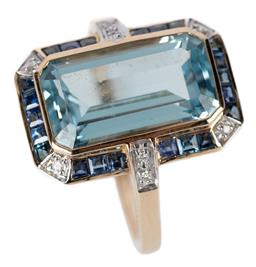 Sale 9140 - Lot 341 - A RETRO STYLE TOPAZ SAPPHIRE AND DIAMOND RING; featuring an emerald cut blue topaz of approx. 6.30ct to surround and shoulders set w...