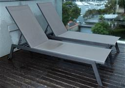 Sale 9150H - Lot 99 - A pair of Alives Garden reclining deck chairs, base length 170cm