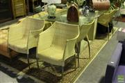 Sale 8499 - Lot 1036 - Glass Top Seven Piece Dining Setting incl. Glass Top Twin Pedestal Table & Six Wicker Chairs