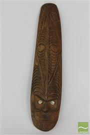 Sale 8520T - Lot 57 - Light wood carved mask hooked scroll nose, Cowrie eyes. 41cm x 9.5.